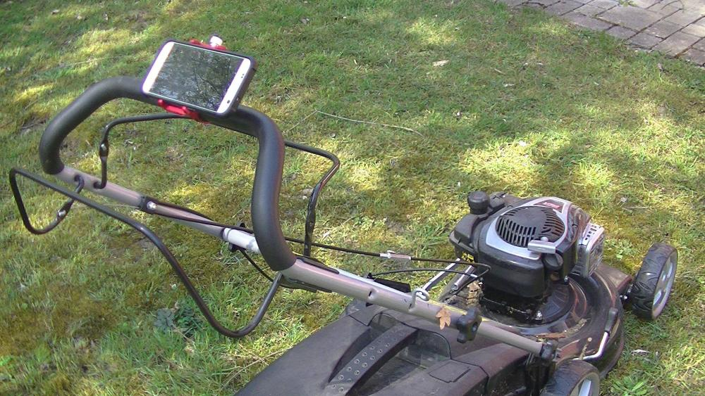 Smartphone holder for motorcycle, bicycle or even on the lawn mower.